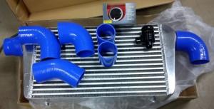 Intercooler, silikonslangar, dumpventil och laddtrycksmätare.